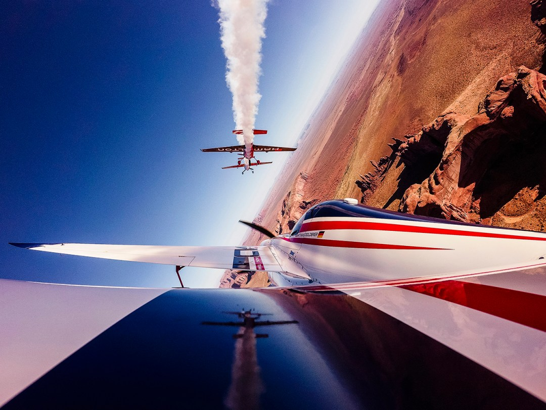 Kirby Chambliss of the United States leads Nicolas Ivanoff of France and Matthias Dolderer of Germany over the Monument Valley Navajo Tribal Park in Utah, United States on September 29, 2015. The pilots are ferrying their race planes to the season final of the Red Bull Air Race World Championship held in Las Veags on October 18. // Armin Walcher / Red Bull Content Pool // P-20150930-00065 // Usage for editorial use only // Please go to www.redbullcontentpool.com for further information. //