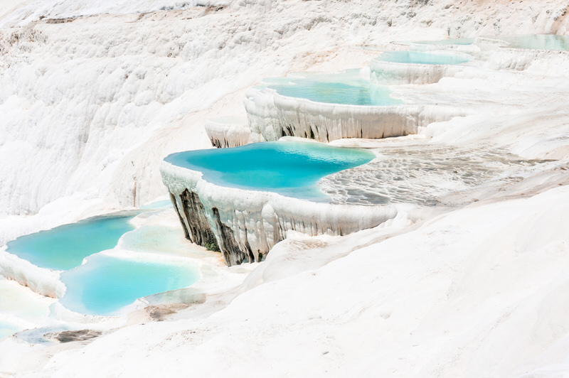 The Spectacular travertine pools and terraces of Pamukkale, Turkey.