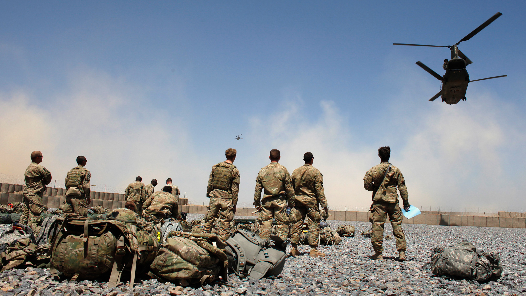 Helicopters carrying U.S. Army soldiers from the 1-320 Field Artillery Regiment, 101st Airborne Division, take off from Combat Outpost Terra Nova as the soldiers head home following a 10-month deployment in the Arghandab Valley north of Kandahar April 23, 2011.  REUTERS/Bob Strong  (AFGHANISTAN - Tags: MILITARY POLITICS IMAGES OF THE DAY)