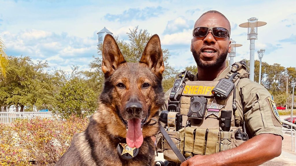 Deputy Dawson with his K-9 partner, Baro. Dawson rescued toddlers from a burning house in Flagler County, Florida. (Flagler County Sheriff's Office/Zenger)