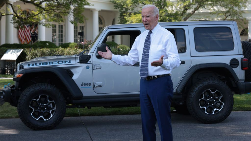 U.S. President Joseph R. Biden Jr. talks to reporters after driving an electric Jeep Wrangler Rubicon Xe around the White House driveway on Aug. 5, 2021. Biden delivered remarks on the administration's efforts to strengthen American leadership on clean cars and trucks. (Win McNamee/Getty Images)