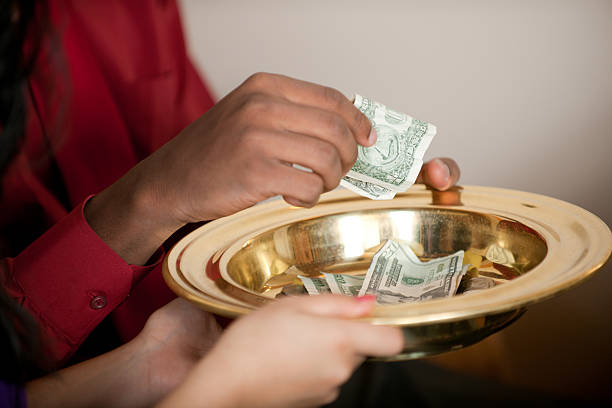 People giving tithes and offerings in church