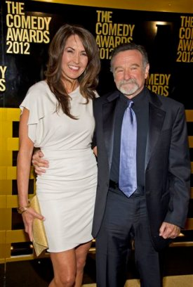 FILE -  In this April 28, 2012, file photo Robin Williams, right, and his wife, Susan Schneider arrive to the 2012 Comedy Awards in New York. Attorneys for Robin Williams' widow and his children have reached a settlement in their legal fight over his estate. (AP Photo/Charles Sykes, File)