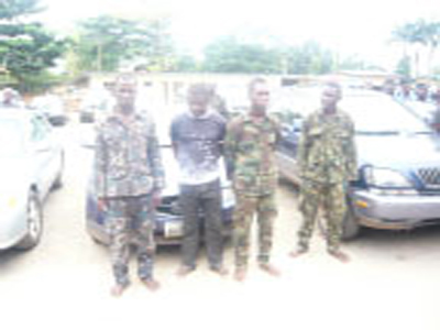 Police parade 'fake soldiers, car thieves'