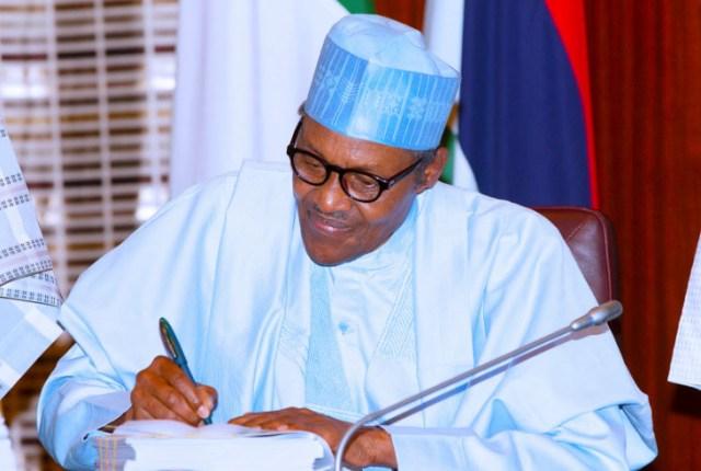 Buhari-Signing-Budget-2.jpg?profile=RESIZE_710x