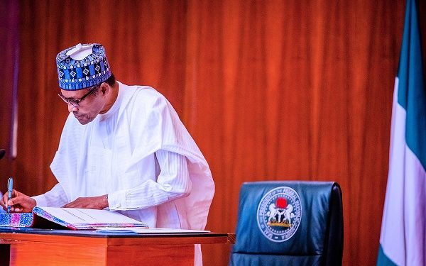 BREAKING: Buhari swears in four new Permanent Secretaries