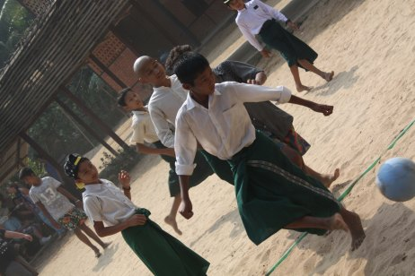 Burmese students playing football soccer in Ngwe Saung Myanmar on Semester at Sea Photo Credit Zack Neher