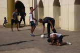 Michael Collett playing soccer football outside of Hassan II Mosque or Grande Mosquée Hassan II in Casablanca Morocco on Semester at Sea Photo Credit Zack Neher