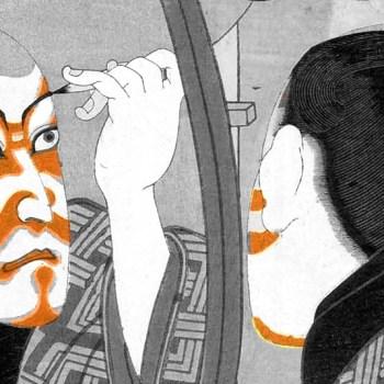 Kabuki actor applies face paint