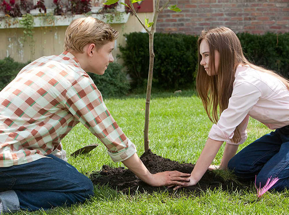 Bryce and Juli planting her new tree