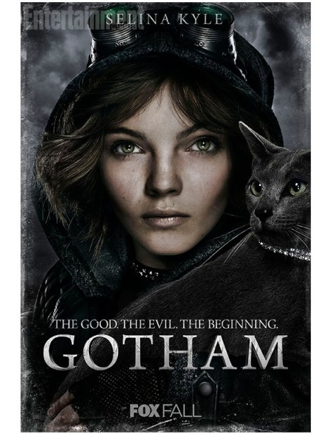Image of a young white woman with green eyes. She's wearing goggles and a dark hoodie. A dark grey cat is by her shoulder. The text on the image says: Selina Kyle. The Good. The Evil. The Beginning. GOTHAM. Fox Fall