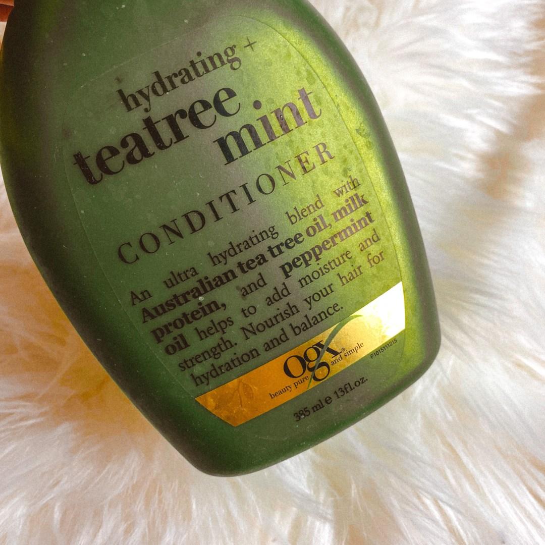 Empty OGX Hydrating Tea Tree Oil Conditooner
