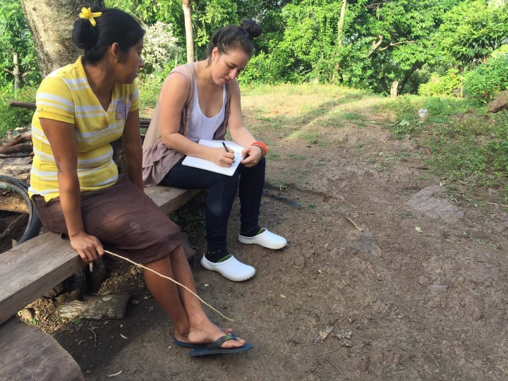 Alyeriz conducting impact evaluation interviews with famiy garden participants.jpg