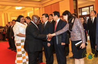 President Akufo-Addo exchanging pleasantries with an official of the Chinese Government