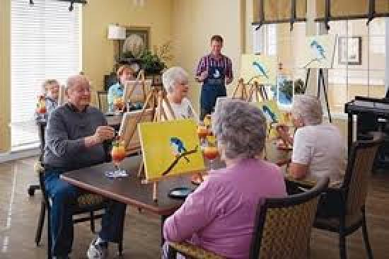 Activities like painting are offered in an assisted living community
