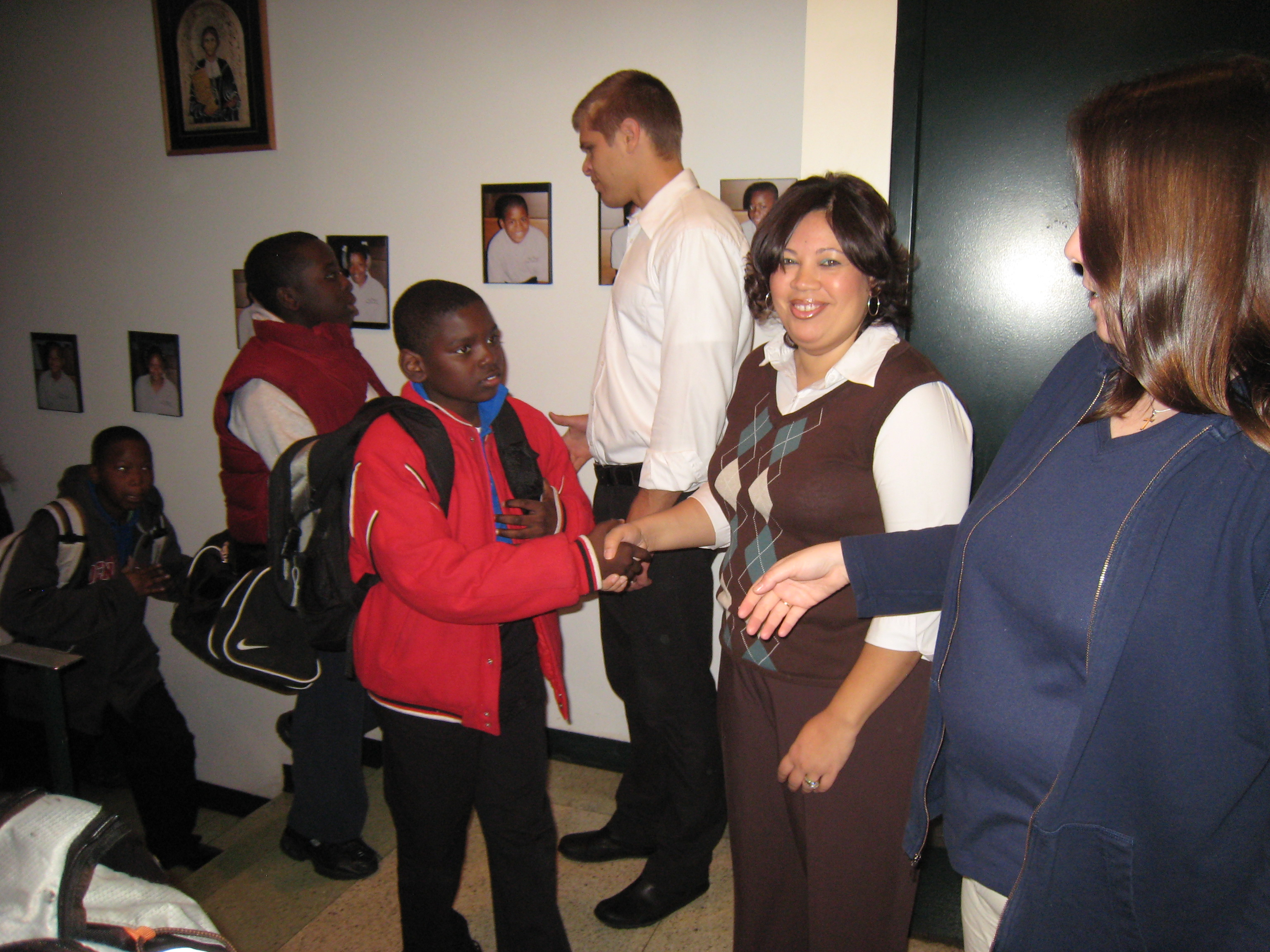 Comer Staff greeting students as they enter the building