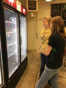 Blacksburg, Va., March 30- Restocking: Senior Linnea Danielson and junior Madison Slaven restock the Meat Center Store on the Virginia Tech Campus. Both women plan on working with the cattle industry after college. Photo: Katie Lukens