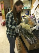 Blacksburg, Va., March 30- Conditioning Flowers: Virginia Tech senior, Paryce Bradlly, works to condition flowers for the floral design class. Bradlly plans to be an agriculture educator after college. Photo: Katie Lukens