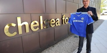 Chelsea FC via Press Association Images MINIMUM FEE 40GBP PER IMAGE - CONTACT PRESS ASSOCIATION IMAGES FOR FURTHER INFORMATION. New Chelsea manager Jose Mourinho holds up the club shirt