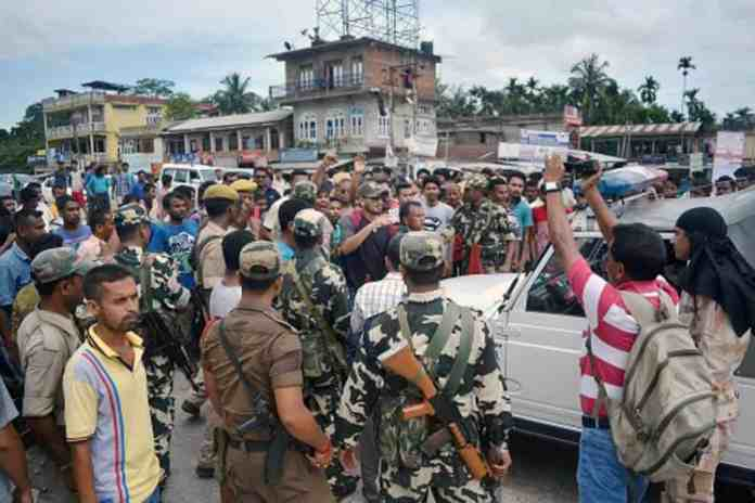 People block the National Highway demanding setting of the AIIMS at Raha in Nagaon district of Assam