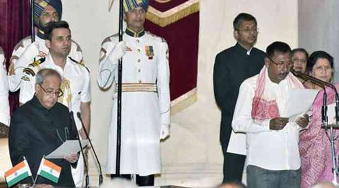 President Pranab Mukherjee administering the oath as Minister of State to Rajen Gohain, at a Swearing-in Ceremony, at Rashtrapati Bhavan, in New Delhi on July 05, 2016