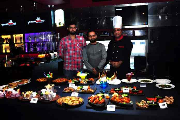 Underdoggs Guwahati franchise owner Rahul Jasrasaria (R) and brand manager at Underdoggs Karan Chadha introducing the new menu and other exclusive offers at the Underdoggs Sports Bar & Grill in Guwahati on December 2, 2016. Photo by Underdoggs/Life's Purple