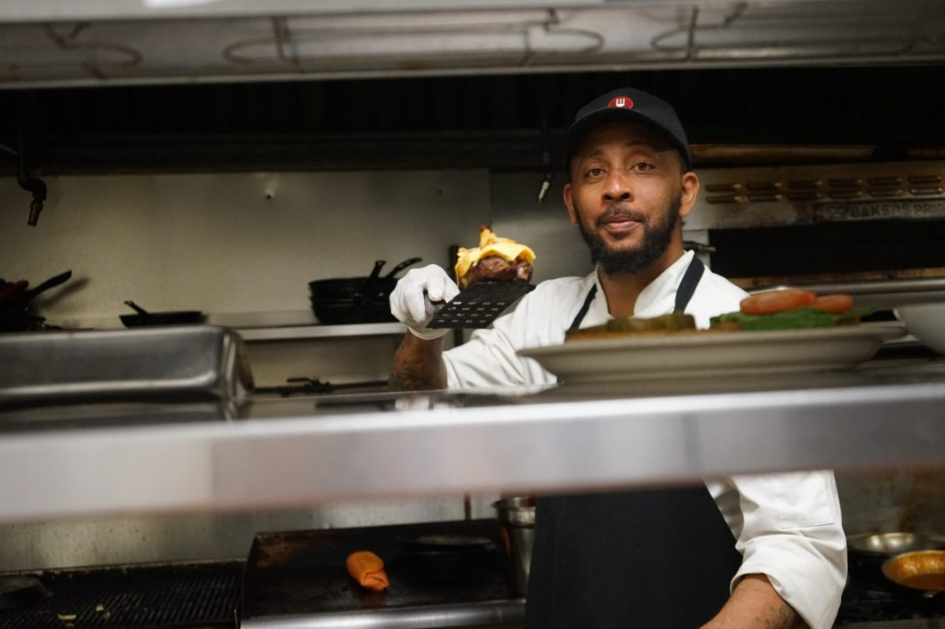 Karim Bryant in the kitchen at Lil Greenhouse Grill (Credit: Roshan Nebhrajani/The New Tropic)