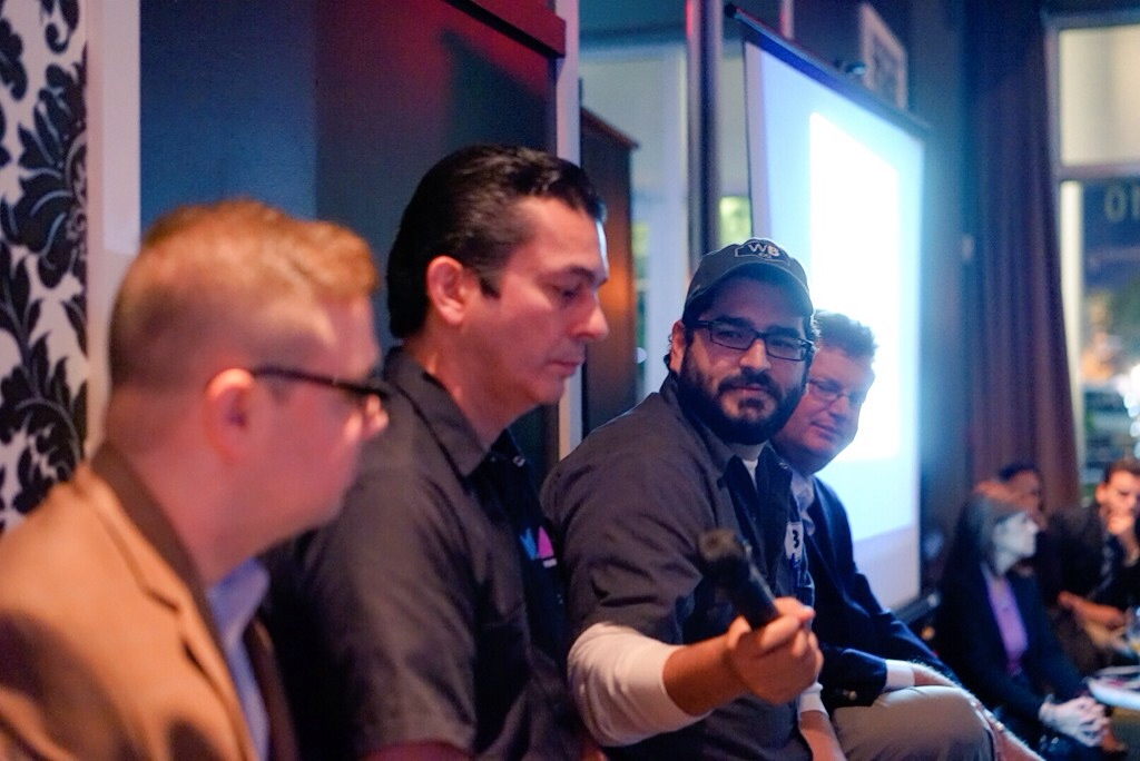 Luis Brignoni, of Wynwood Brewing, passes the mic to Eddie Leon, of M.I.A. Brewing, during a recent meeting of Miami Young Republicans, where attendees discussed regulatory issues over craft beer. (Courtesy of Marco A. Leyte-Vidal, III)