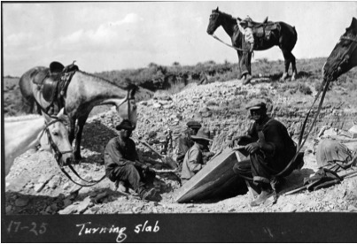 Local ranchers help turn over the slab. (University Archives, Fort Hays State University, Hays, KS)