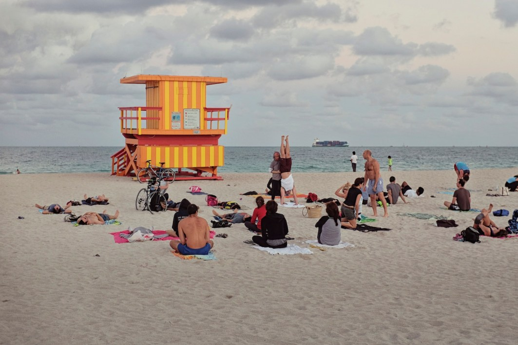 3rd Street: Yoga on Third meets here twice a day at sunrise and sunset. I love the colors on this stand, but I came to shoot yoga because it really captures how the beach is such a deep part of Miami's lifestyle and how we use these stands as the meeting places here. (Sean R. Sullivan, seanwashere.com)