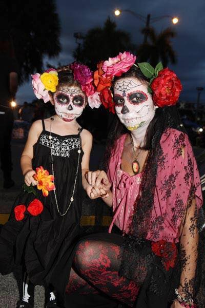 A woman and her daughter at the annual Day of the Dead parade. (Courtesy of South Florida Day of the Dead Celebration)