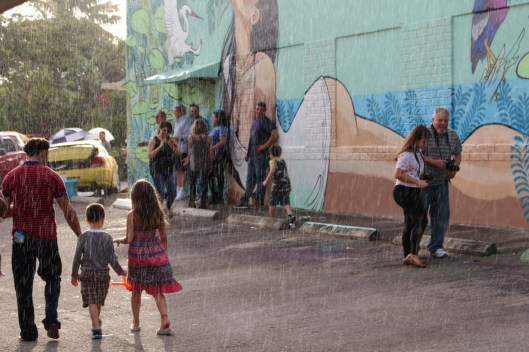 Rain doesn't stop the Leah Arts District Street Fair. (Courtesy of JLPR)