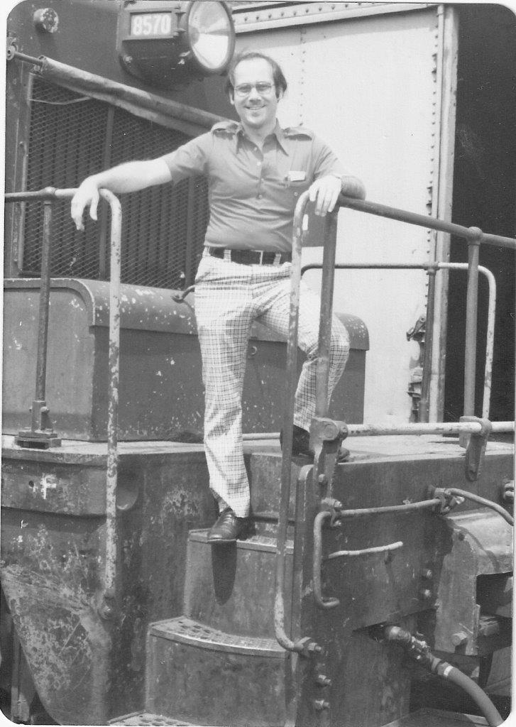 Seth Bramson on a diesel locomotive.