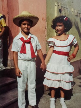 Quintana and her schoolmate in traditional Cuban dress.