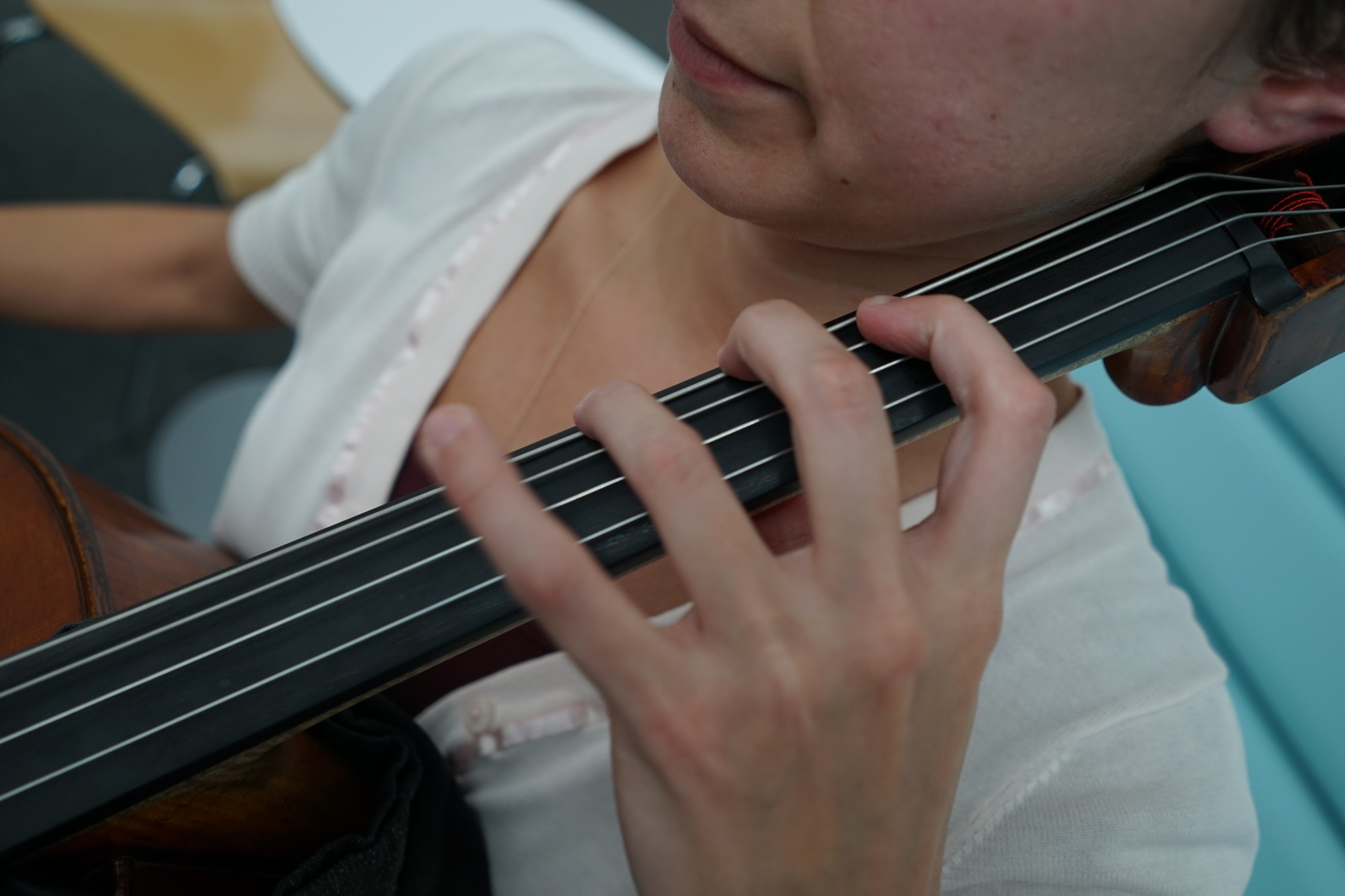 The neck and fingerboard. This is what controls the notes on the cello along with the movement of the bow.