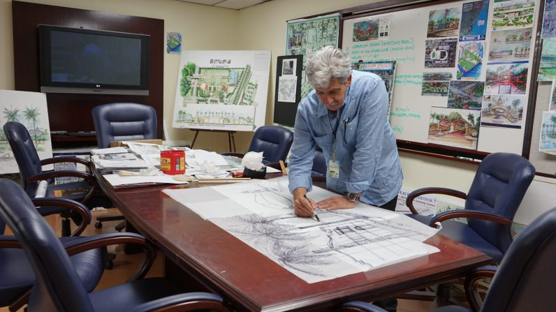 Architect J.C. Garrido draws renderings for a gateway to west Coconut Grove inside the offices of Commissioner Xavier Suarez