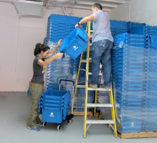 The Camps family unloads their StowSimple bins.