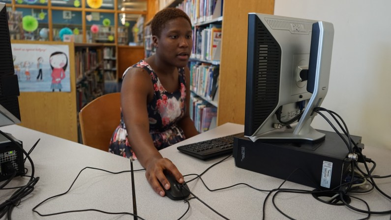 Shel-Neisha Bromell uses a computer at her public library.
