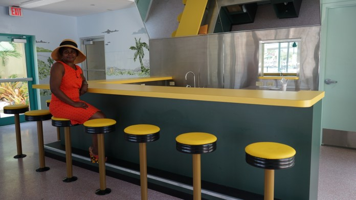 Yellow bar stools line the former 24-hour diner (Credit: Roshan Nebhrajani/The New Tropic)