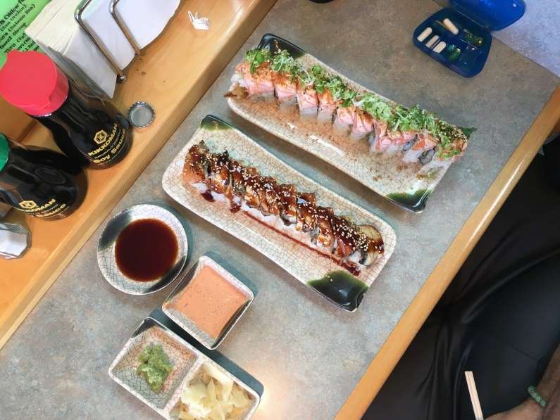 Crunchy shrimp roll with eel on top an the Love roll, made with soft shell crab, salmon, and truffle oil. (Credit: Roshan Nebhrajani/The New Tropic)