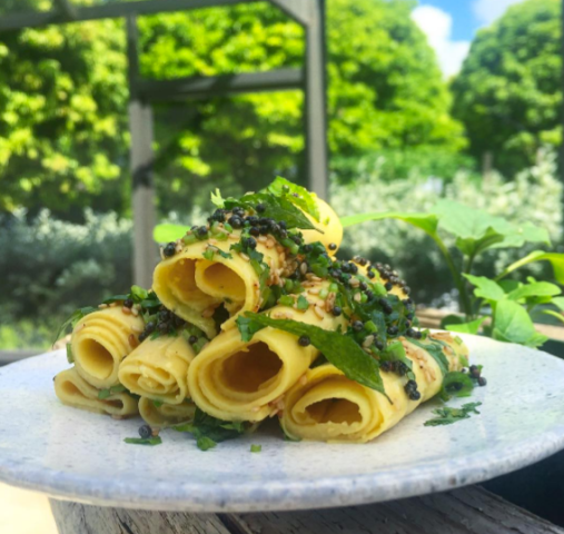 Khandvi or Paturi, chickpea flour cooked with yogurt, lemon, Thai chiles, ginger. Once cooked, top it with curry leaves, sesame, black mustard, cilantro. (Courtesy of Niven Patel)