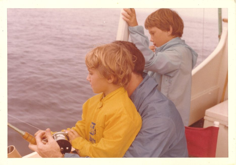Fishing. Sam is in sitting on John's lap with his brother Rob behind them. Circa 1972. (Courtesy of Sam Van Leer)