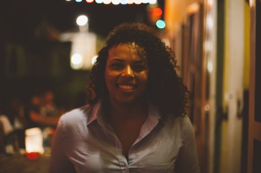 Tirzah Statia, recent return to Curaçao / I was born and raised in Curaçao and I love the island. I lived here until I was 18, then I moved to Europe, and after 16 years I came back. I've been back for about 11 months. My whole family is here. My family is a combination of Dutch, German, Spanish, and Dominican. Some of my mom's ancestors were slave owners, but we know the other side of the family is descended from slaves based on our last name. I'm the only dark one in my family on my mother's side. My grandfather is white, with blue eyes, while I'm a mixture, with curly hair and brown skin. What I like about Curaçao is that now you can see that everyone is living together — slave descendents, slave owners, people who just moved to Curaçao during WWI or WWII. I embrace it because you learn from both sides – what slave owners went through as well as the slaves. It's a beautiful history I have here in Curaçao.