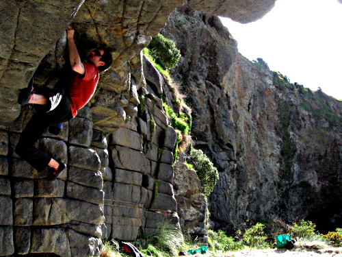 Cave bouldering on Long Beach, Dunedin