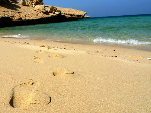 Footprints in the sand, Qantab Beach, Muscat, Oman