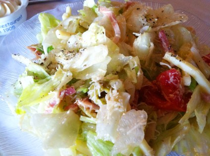 1905 Salad with julienne sliced ham, cheese, tomatoes, green olives, grated romano cheese and tangy garlic dressing.