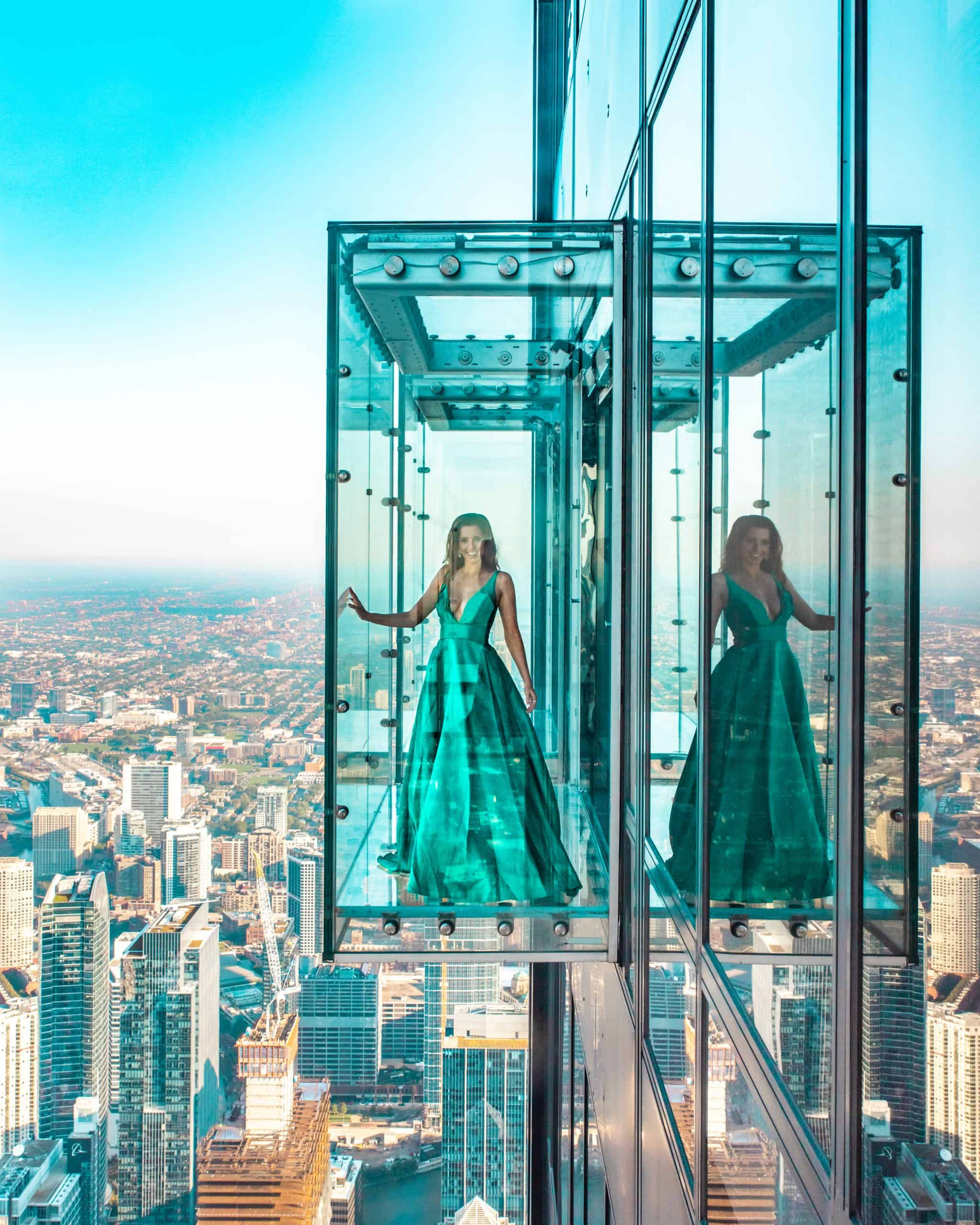 Girl standing on Chicago Skydeck Glass Ledge 1,323 feet above ground - The Next Trip