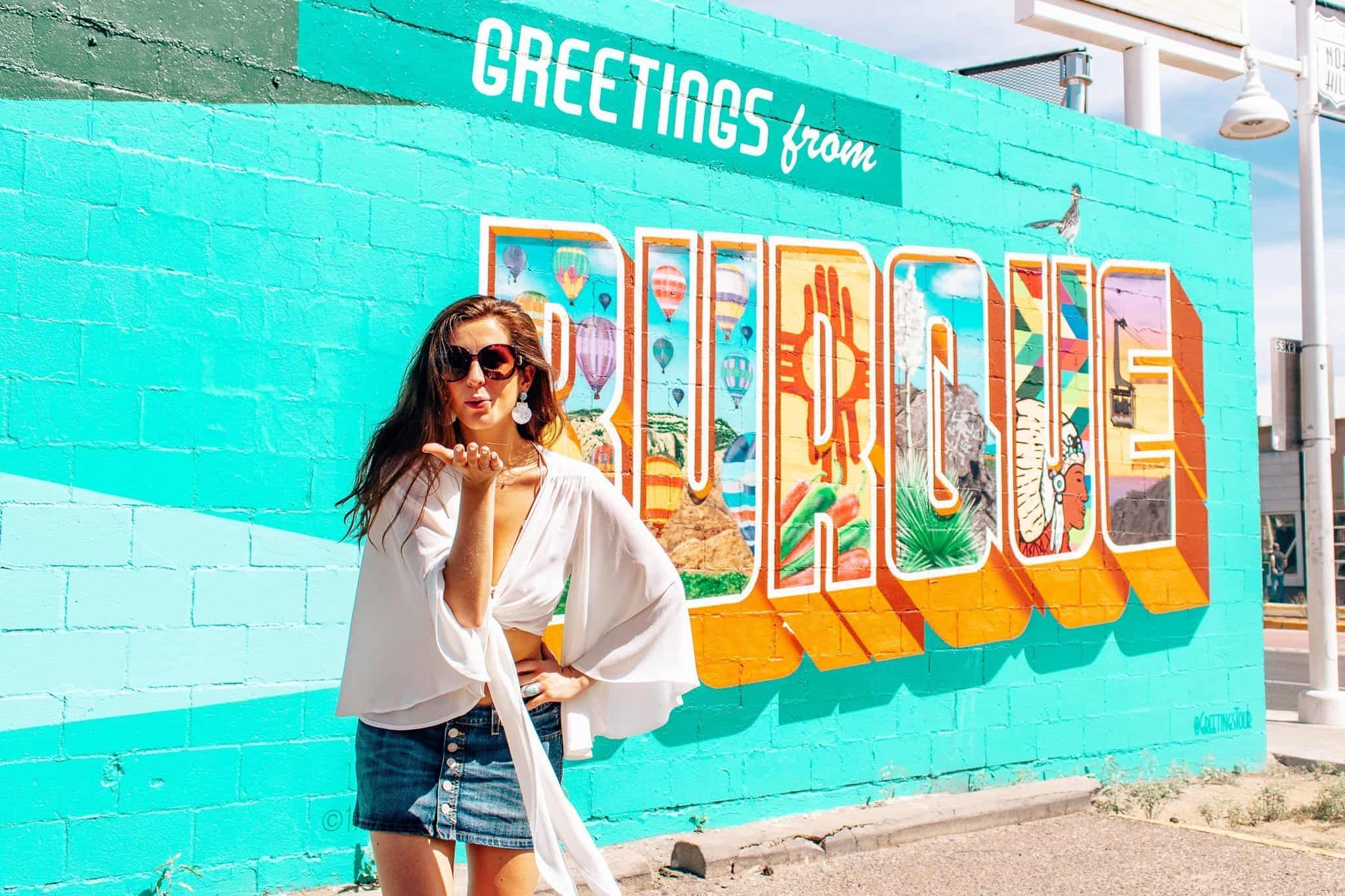 Bettina at Greetings from Burque Mural in Albuquerque - The Next Trip