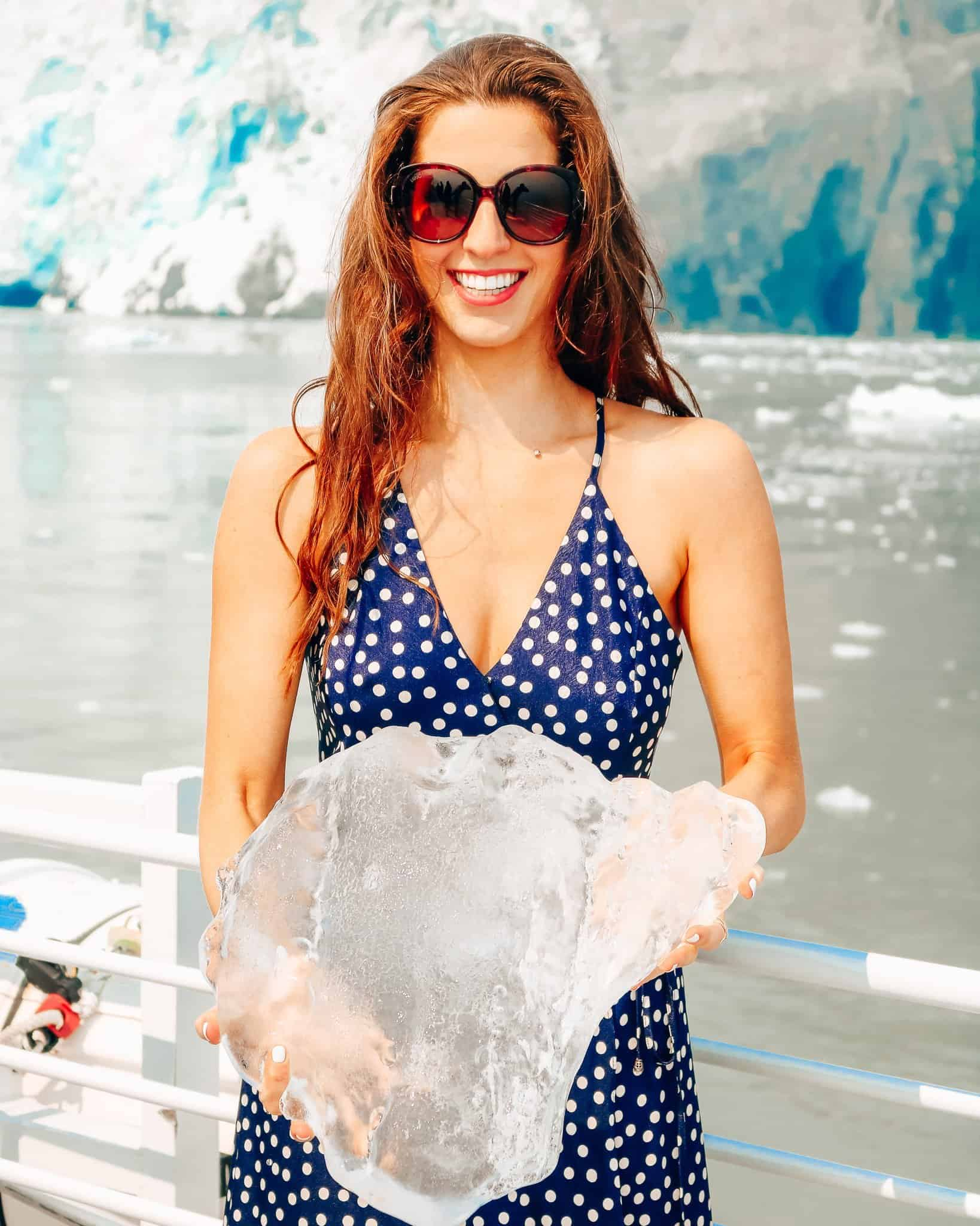 Bettina holding Ice from Aialik Glacier on Pursuit Collection Cruise Kenai Fjord Alaska - The Next Trip