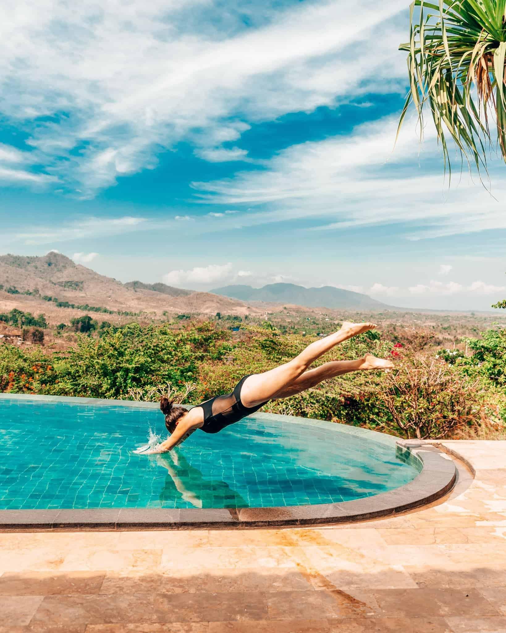 Jumping into the Pool at Sumberkima Hill, Bali - The Next Trip